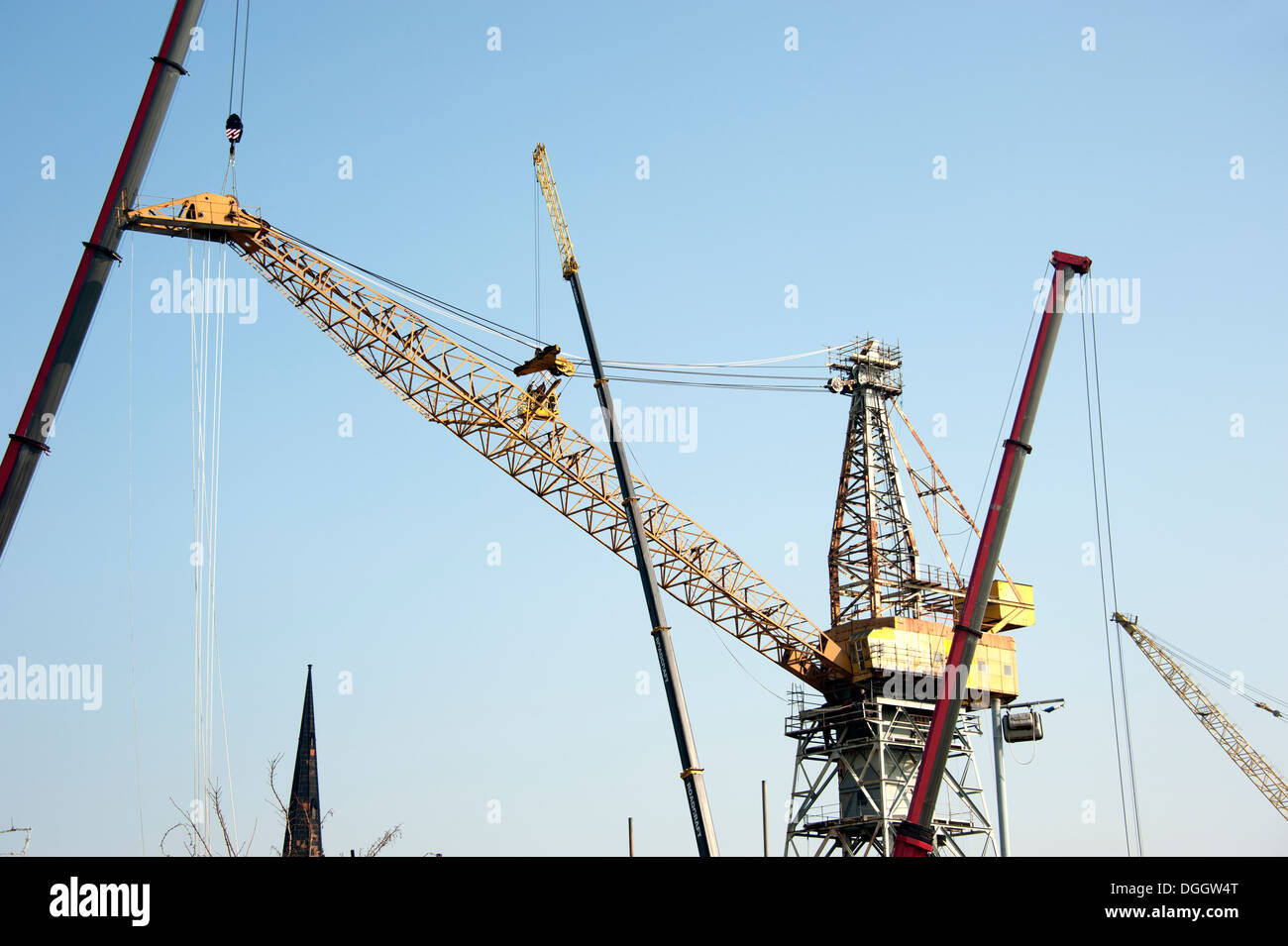 Large Crane being repaired by another crane - Stock Image