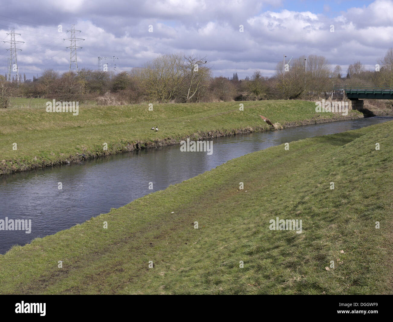View of river and riverbanks, River Tame, Sandwell Valley RSPB Reserve, West Midlands, England, April - Stock Image