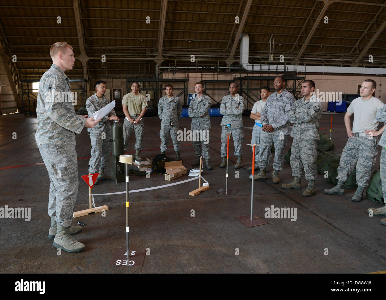 Airman 1st Class Trevor Greentree, 374th Civil Engineer Squadron, briefs Airman on unexploded ordinance detection and how to perform post attack reconnaissance correctly during the ability to survive and operate rodeo at Yokota Air Base, Japan, Oct. 8, 20 - Stock Image