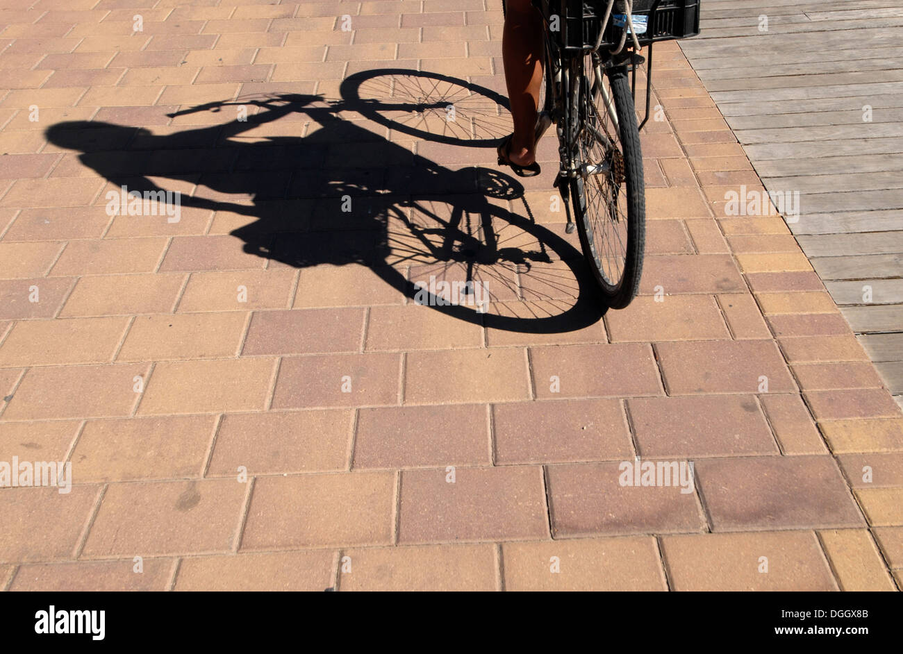 Young brazilian woman in her bike, La Savina, Formentera Stock Photo