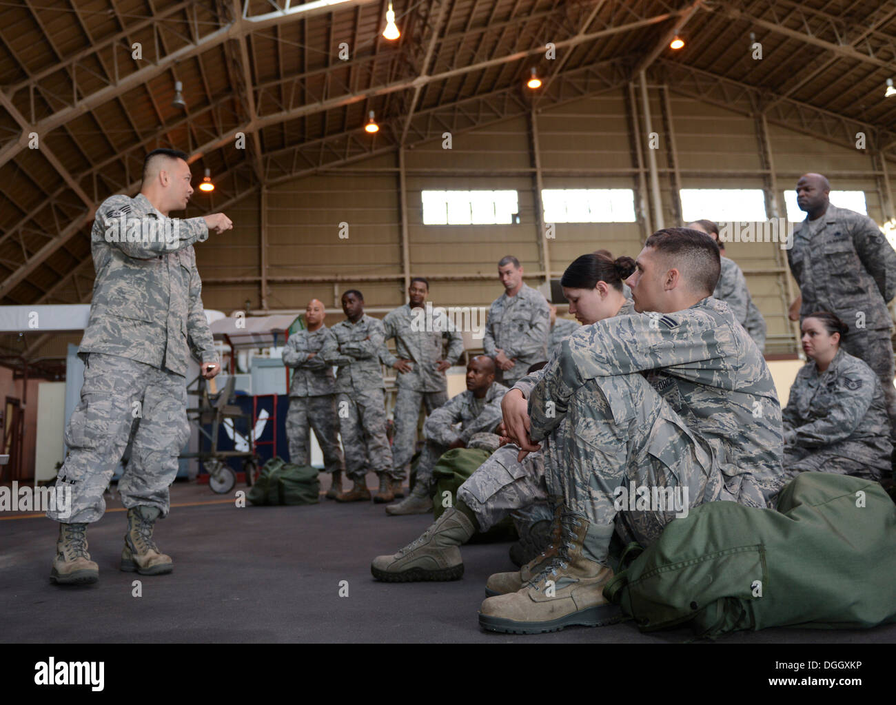 Staff Sgt. Don Flores, 374th Medical Group, briefs a group of Airmen on proper Self Aid Buddy Care techniques and procedures during the ability to survive and operate rodeo at Yokota Air Base, Japan, Oct. 8, 2013. Topics included how to apply a tourniquet - Stock Image