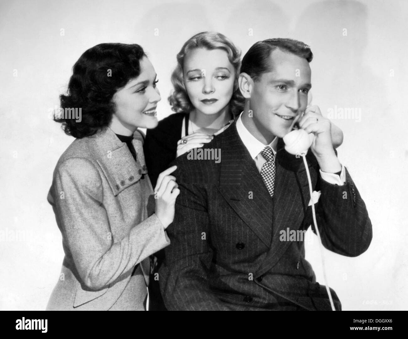 BETWEEN TWO WOMEN 1937 MGM film with from left: Maureen O'Sullivan, Virginia Bruce, Franchot Tone - Stock Image