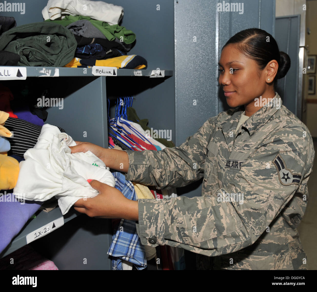 Airman 1st Class Jacklyn Neil folds clothes at the 379th Air Expeditionary Wing in Southwest Asia, Oct. 10, 2013. Personnel Support for Contingency Operations PERSCO personnel maintain clothing for members who have to take emergency leave and depart from - Stock Image
