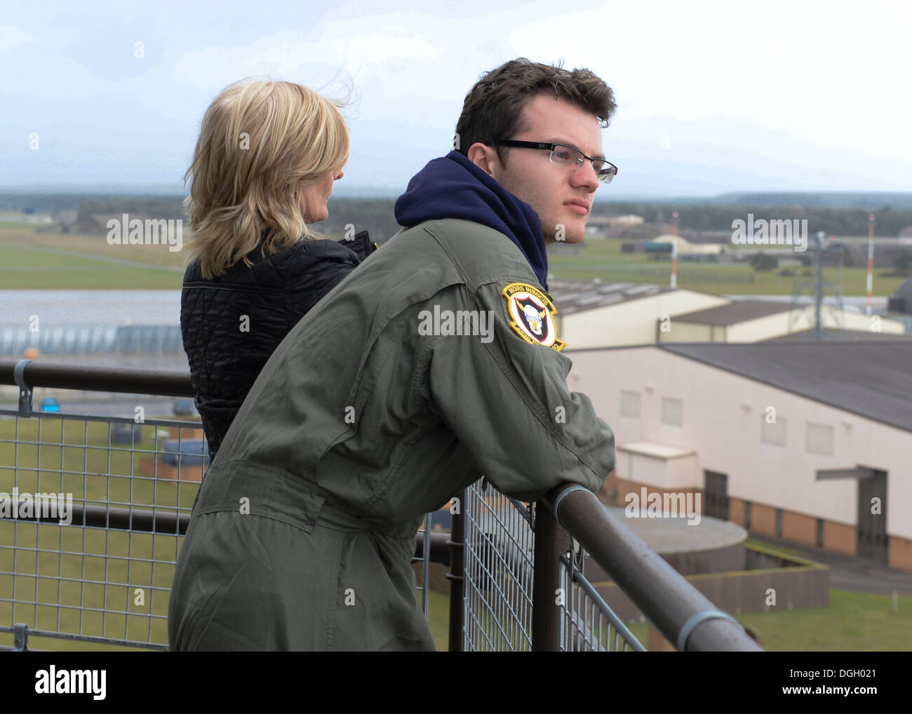 Pilot for a Day participant Stephen Sutton and his mother, Jane Sutton, view the base from the air traffic control tower on Royal Air Force Lakenheath, England, Oct. 10, 2013. Pilot for a Day, started in 2012, gives local children with serious illnesses a - Stock Image