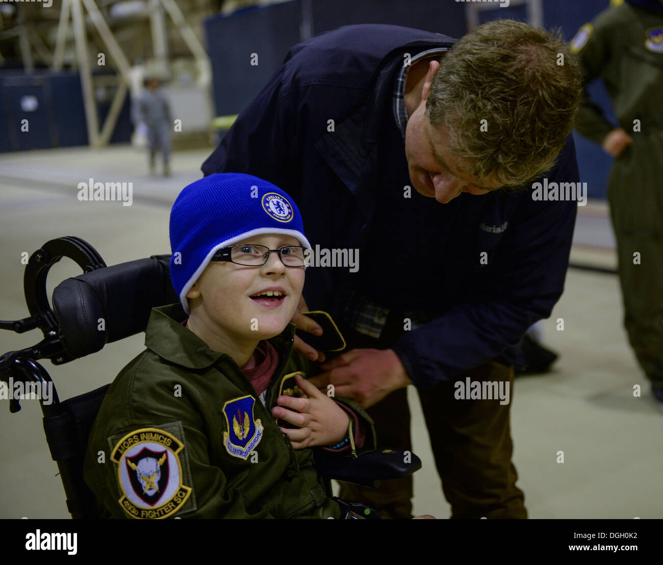 Pilot for a Day participant Ethan Ridd receives an honorary pilot's wings nameplate at Hangar 7 on Royal Air Force Lakenheath, England, Oct. 10, 2013. Pilot for a Day, started in 2012, gives local children with serious illnesses a day away from routine ho - Stock Image