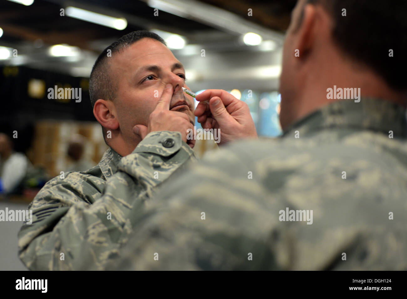 SPANGDAHLEM AIR BASE, Germany—Tech. Sgt. Damian Horton, 52nd Aircraft Maintenance Squadron flightline expediter, from Cooper City, Fla., receives his flu mist injection during a medical exercise Oct. 16, 2013. The 52nd Public Health Emergency Office lever - Stock Image
