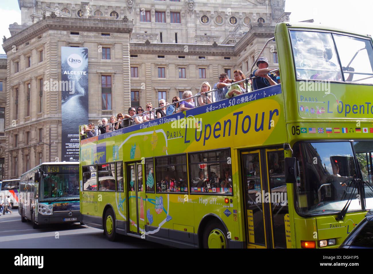 Paris France Europe French 9th arrondissement Rue Scribe Palais Garnier Opera National de Paris tour bus double decker L OpenTou - Stock Image