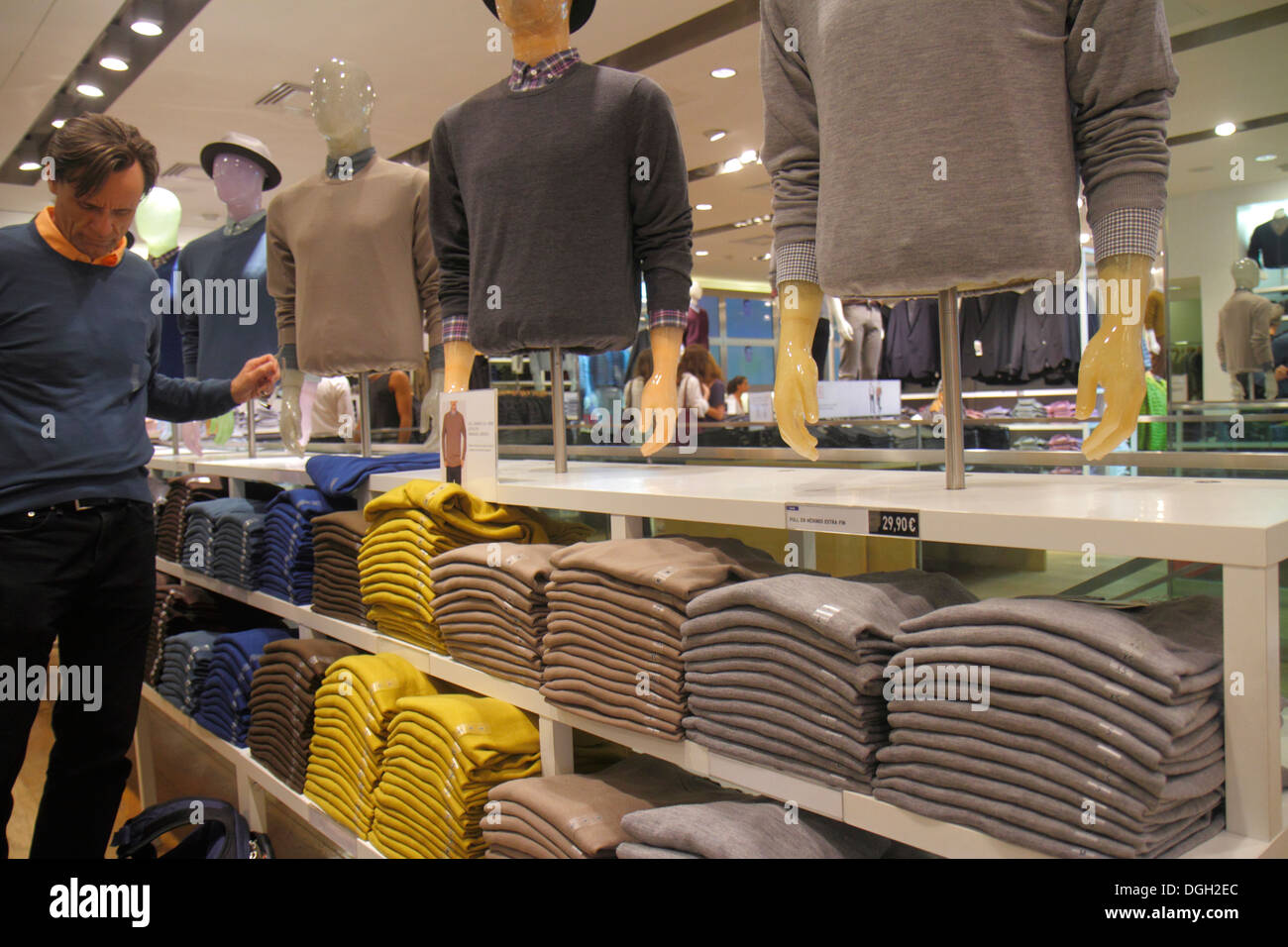 Paris France Europe French 9th arrondissement Rue Scribe shopping Uniqlo clothing store fashion sale retail display men's sweate - Stock Image