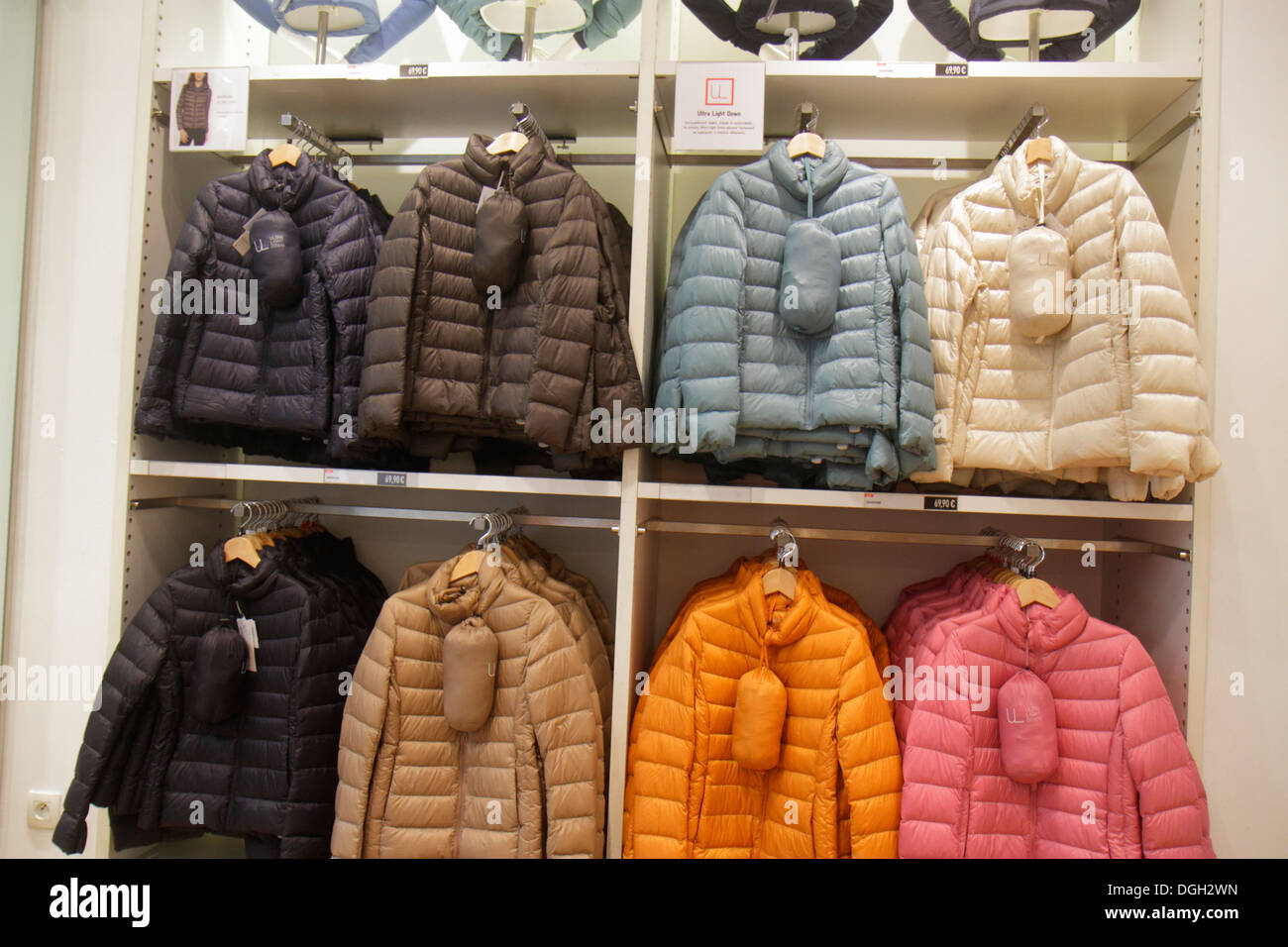 Paris France Europe French 9th arrondissement Rue Scribe shopping Uniqlo clothing store fashion insulated coats sale retail disp - Stock Image