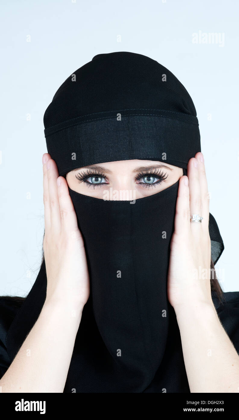 Young white woman with lovely eyes wearing a Niqab - Stock Image