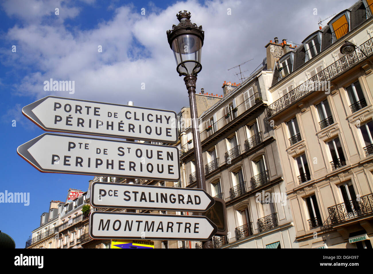 Paris France Europe French 8th 9th 17th 18th arrondissement Place de Clichy lamppost lamp post signs directions arrows historic - Stock Image