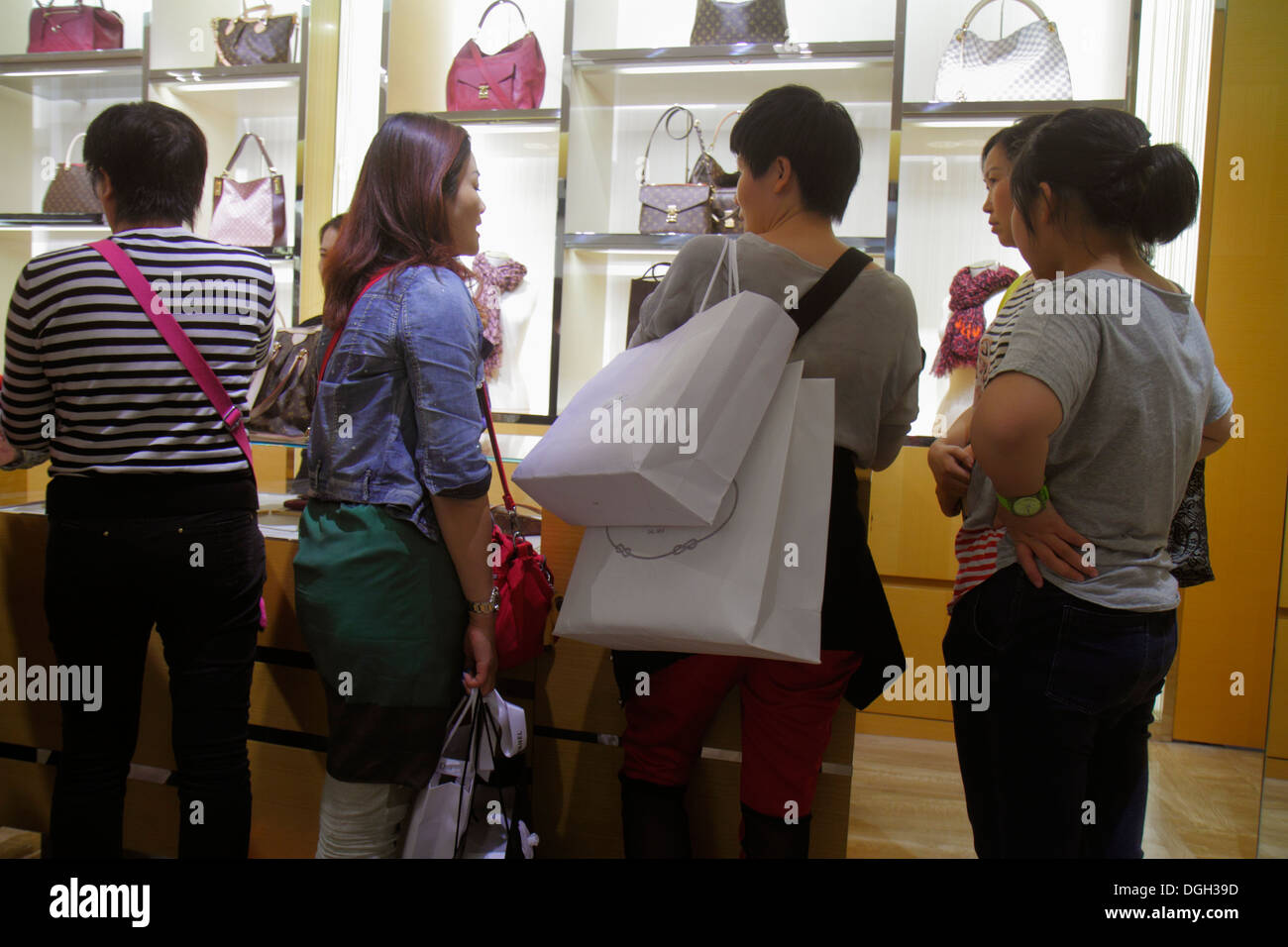 Paris France Europe French 9th arrondissement Boulevard Haussmann Galeries Lafayette department store shopping Asian woman desig - Stock Image