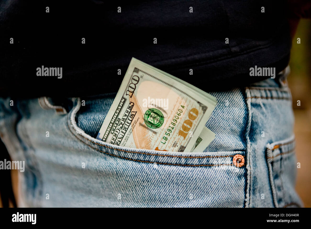 Money sticking out of pants front pocket - Stock Image