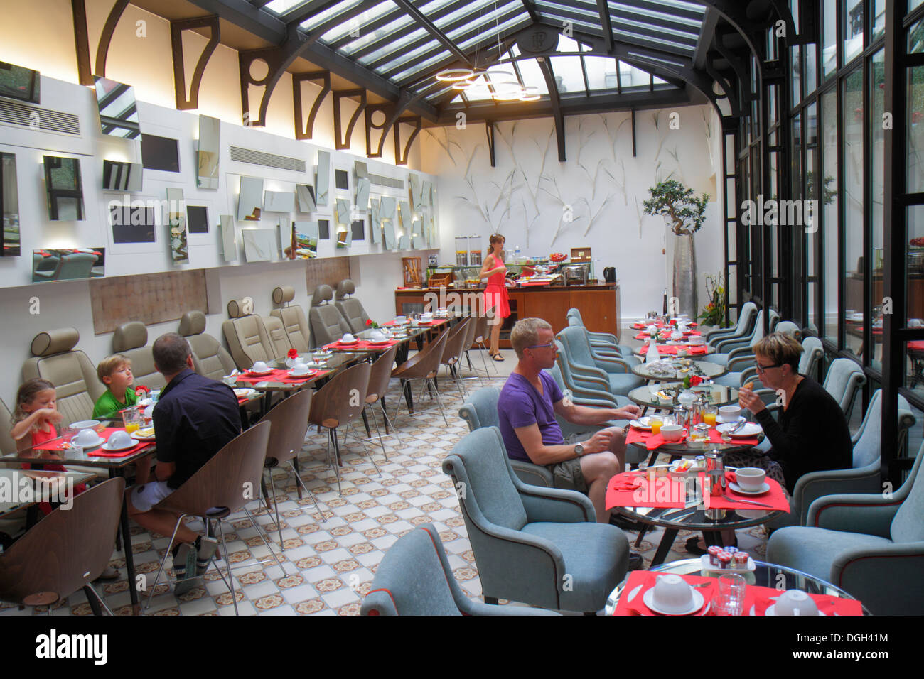Paris France Europe French 9th arrondissement Rue la Bruyere Hotel Joyce Astotel hotel breakfast room guests eating seats tables - Stock Image