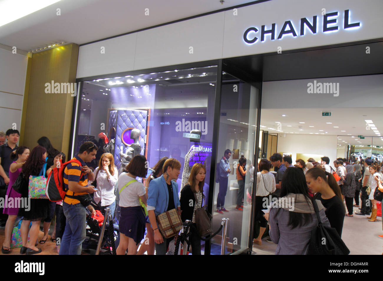 Paris France Europe French 9th arrondissement Boulevard Haussmann Galeries Lafayette department store shopping Asian man woman C - Stock Image