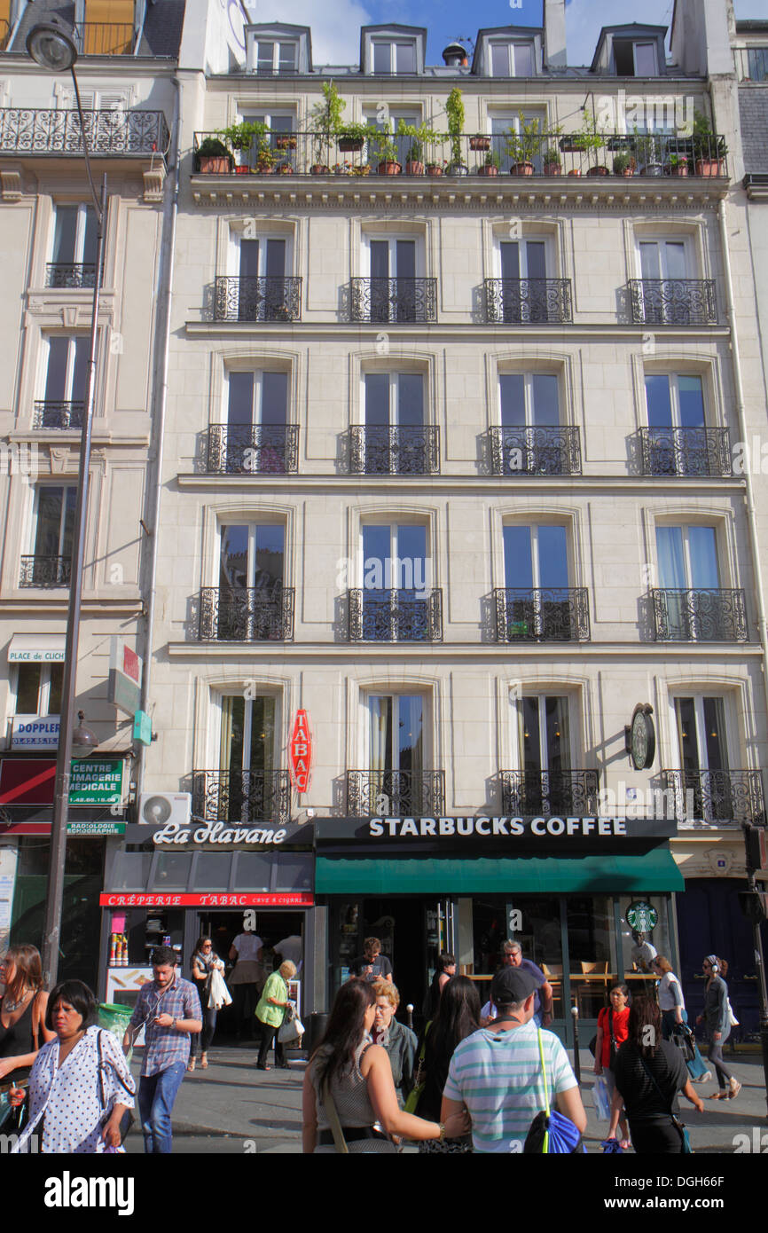 Paris France Europe French 8th 9th 17th 18th arrondissement Place de Clichy Starbucks Coffee exterior entrance pedestrians histo - Stock Image