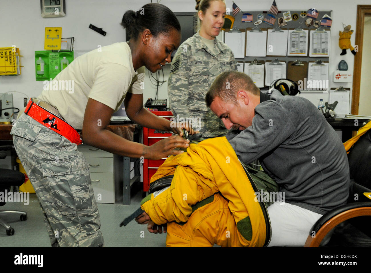 U.S. Staff Sgt. Jasmine Chambers, 99th Expeditionary Reconnaissance Squadron physiological support detachment technician, helps - Stock Image