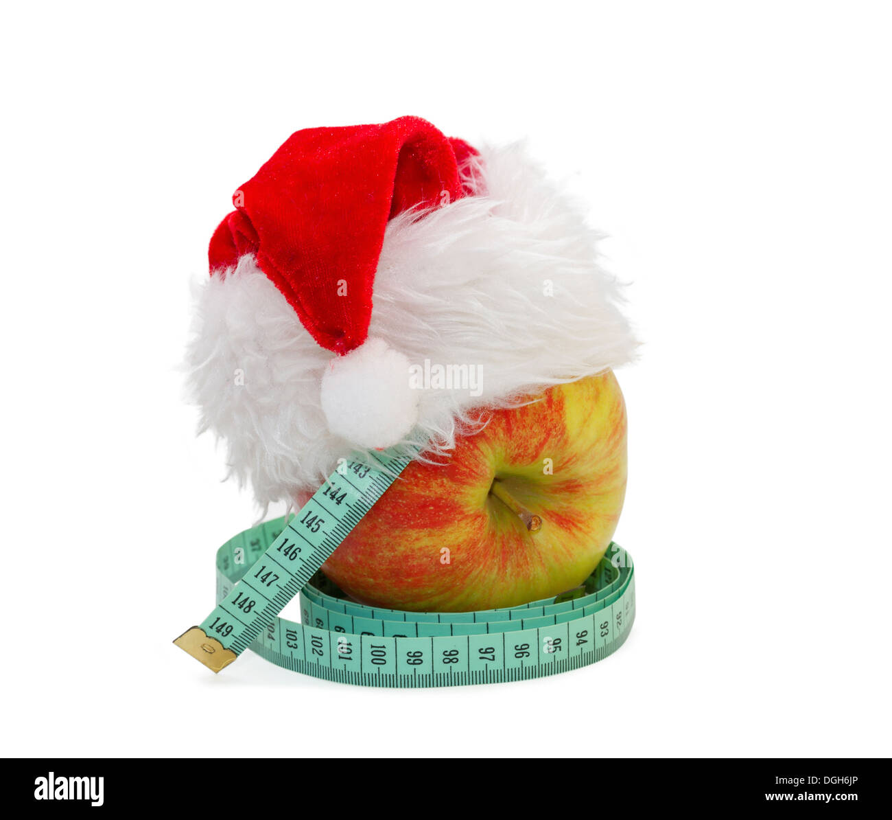 Apple with a measuring meter, in a cap Santa Claus - Stock Image