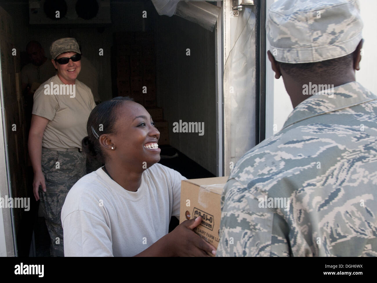 U.S. Air Force Staff Sgt. Padonda Ali, 380th Expeditionary Force Support Squadron food service specialist, takes a box of food to place into storage at an undisclosed location in Southwest Asia, Oct. 8, 2013. Ali was part of a large EFSS team, who all com - Stock Image