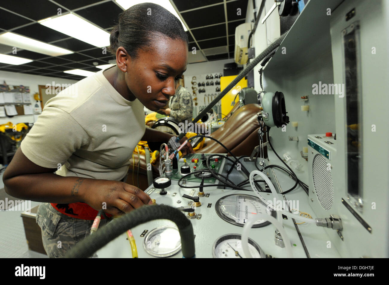 U.S. Staff Sgt. Jasmine Chambers, 99th Expeditionary Reconnaissance Squadron physiological support detachment technician, checks a pressure suit for air leaks during a post-flight inspection at an undisclosed location in Southwest Asia, Oct. 7, 2013. The - Stock Image