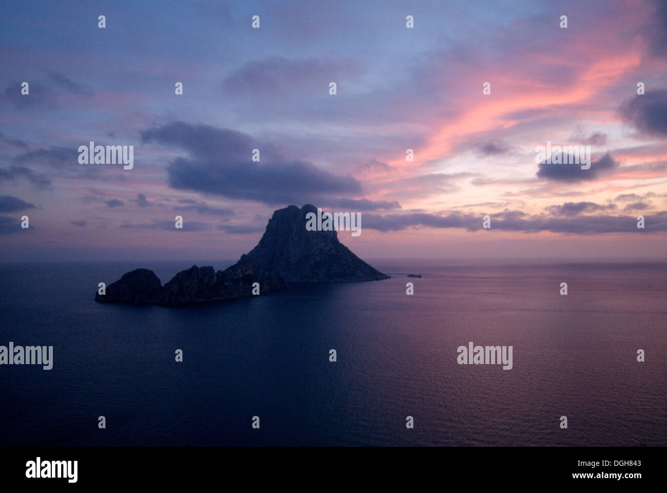 Located off the Southwest coast of Ibiza lies the mysterious rock island Es Vedra, almost 400 m in height, made - Stock Image