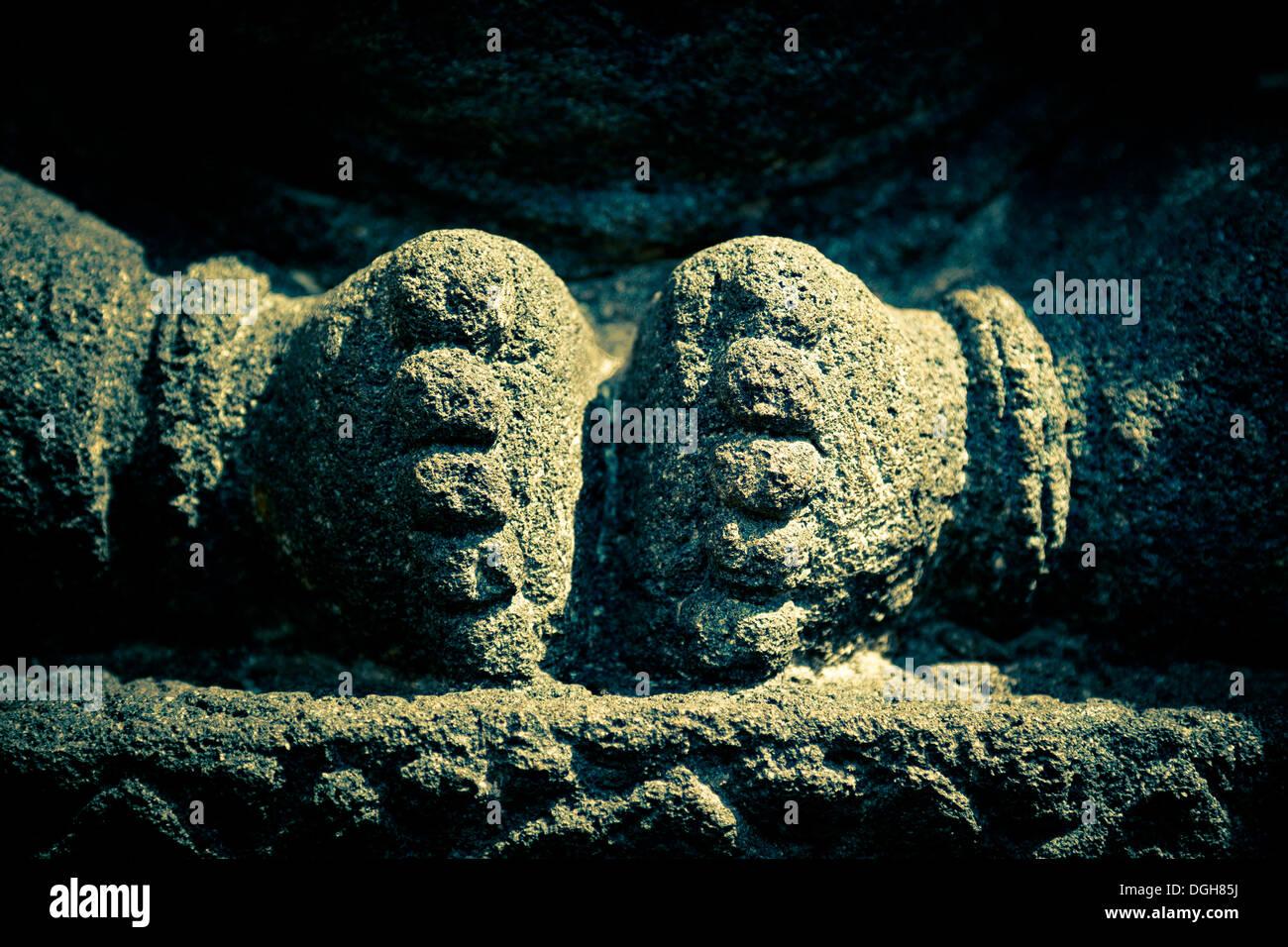 Detail of stone statue in Candi Sambisari,showing pair of feet. Stock Photo