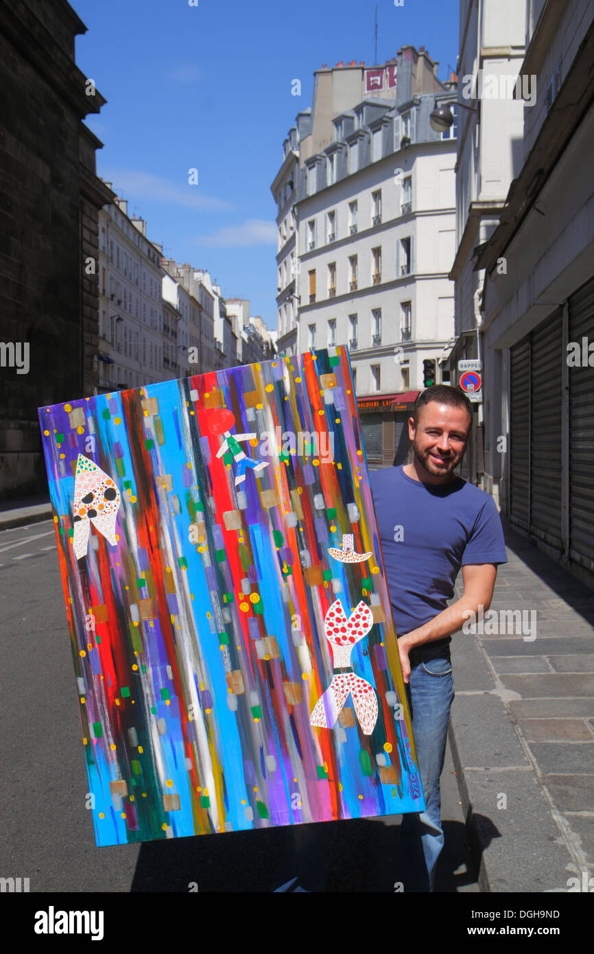 Paris France Europe French 9th arrondissement Rue Flechier man artist painting - Stock Image