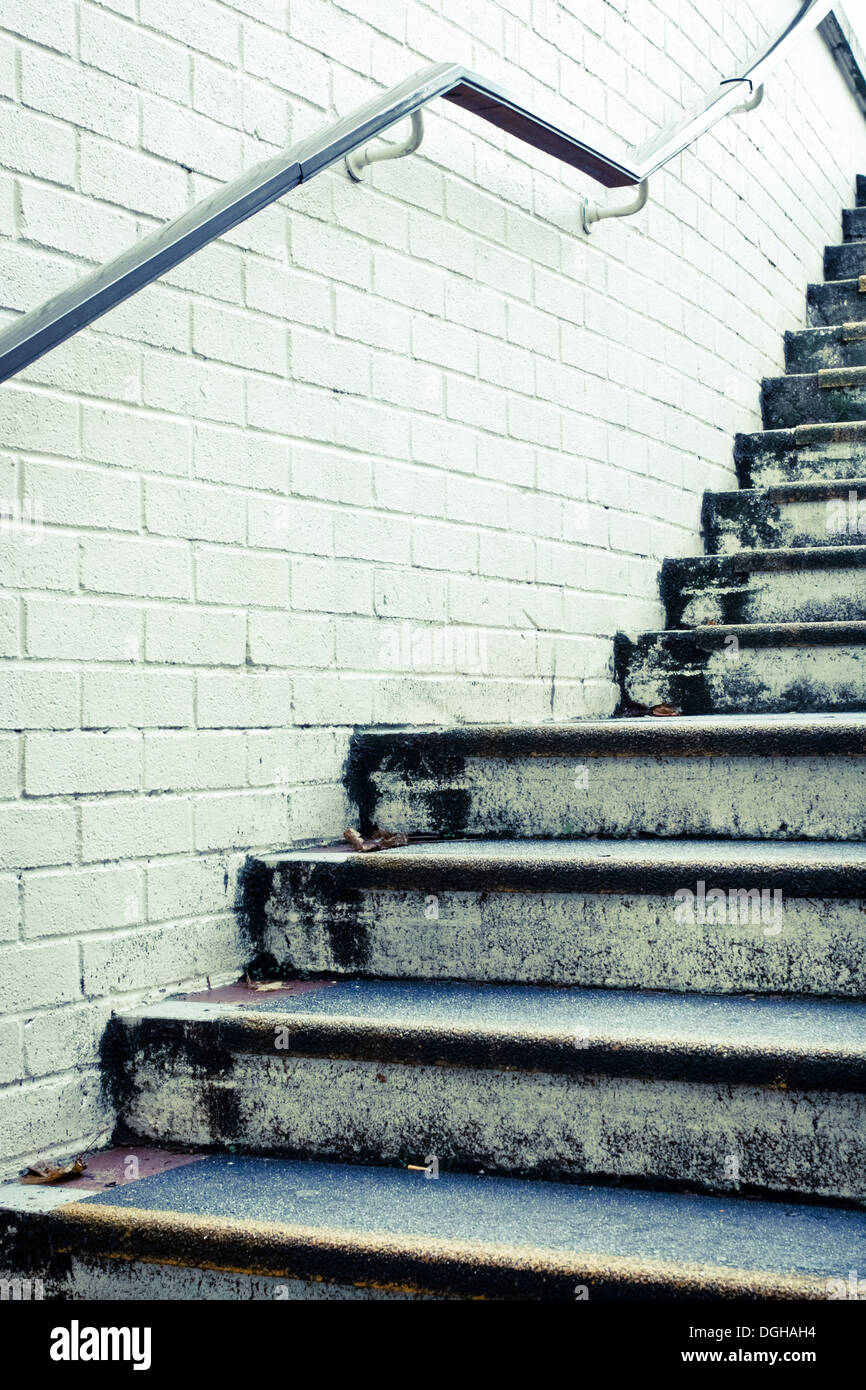 Stone steps and white wall in muted tones - Stock Image