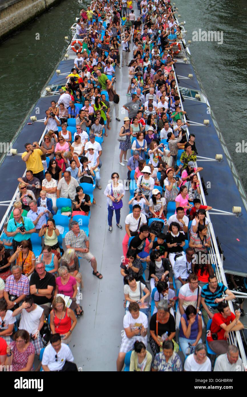 Paris France Europe French Seine River scenic boat cruise passengers Pont au Double Bridge view overhead - Stock Image