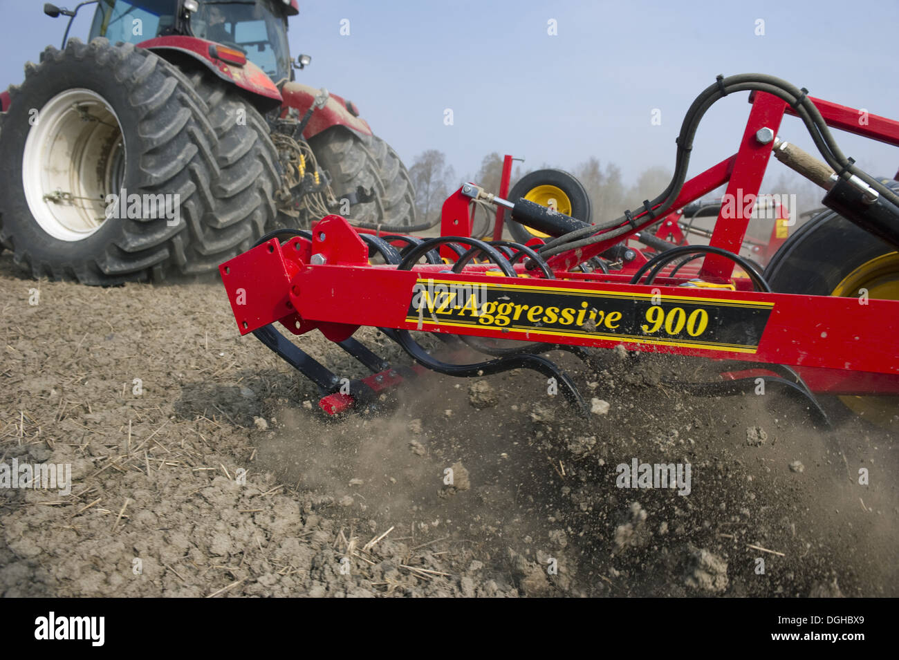 Tractor with Vaderstad NZA-900 harrows, harrowing arable field, Sweden, april - Stock Image