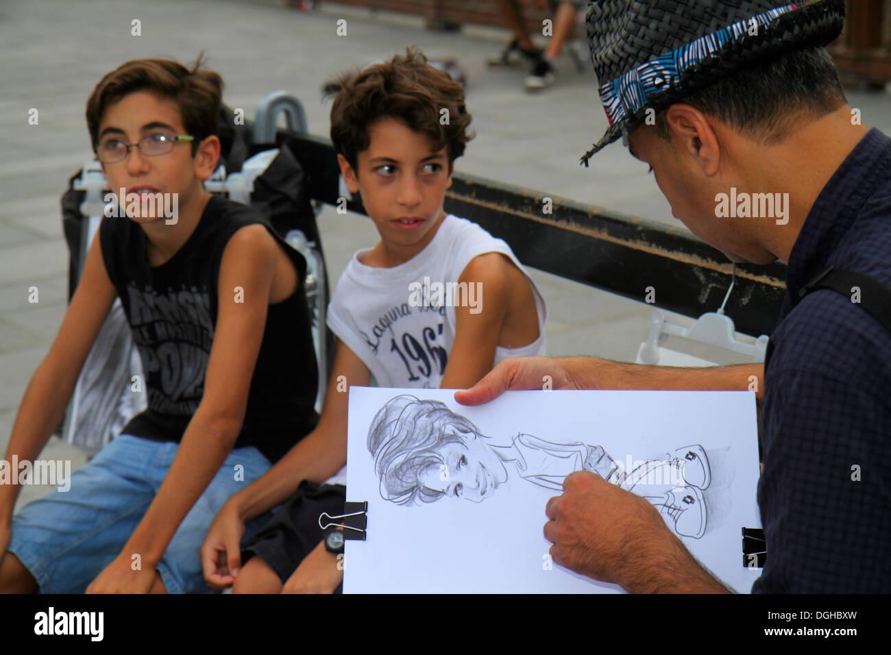 Paris France Europe French Pont au Double Bridge artist drawing caricature boy man sketching - Stock Image