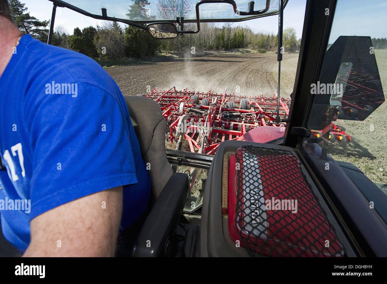 Interior of Case MXM 155 tractor cab with Vaderstad NZ-Aggressive-700 harrows, harrowing arable field, Sweden, may. - Stock Image