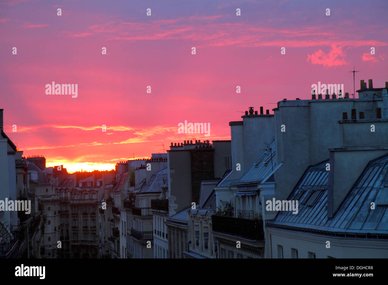 Paris France Europe French 9th arrondissement Rue la Bruyere aerial sunset Haussmann apartment buildings rooftops chimneys - Stock Image