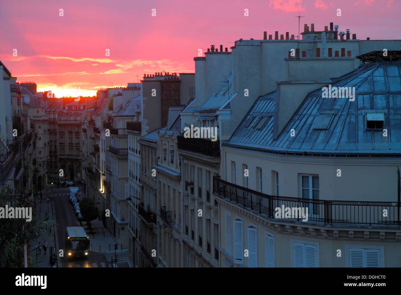 Paris France Europe French 9th arrondissement Rue la Bruyere street aerial sunset Haussmann apartment buildings rooftops chimney - Stock Image