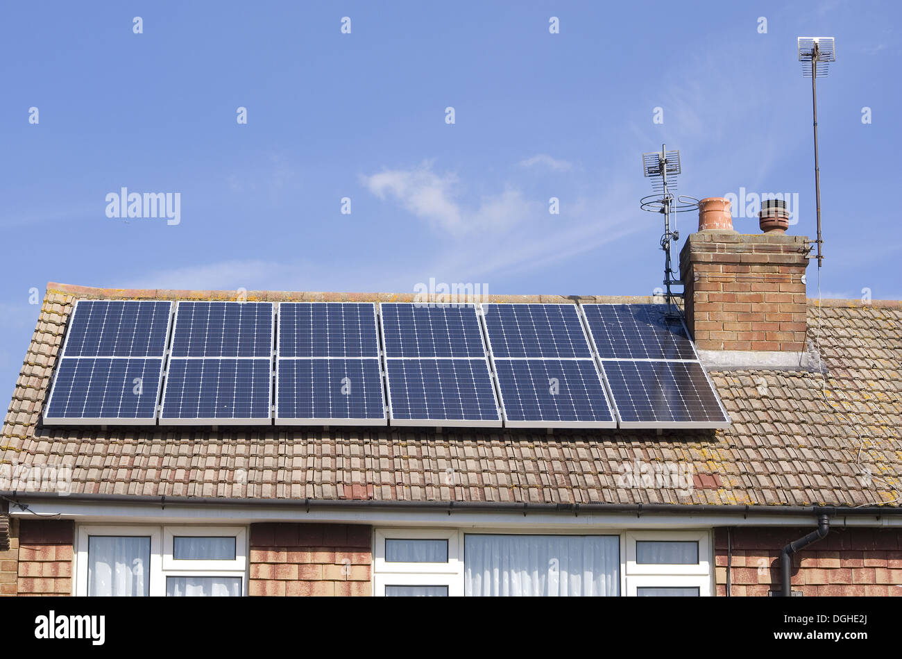 Solar panels for heating domestic hot water, on roof of house, Surrey, England, September - Stock Image