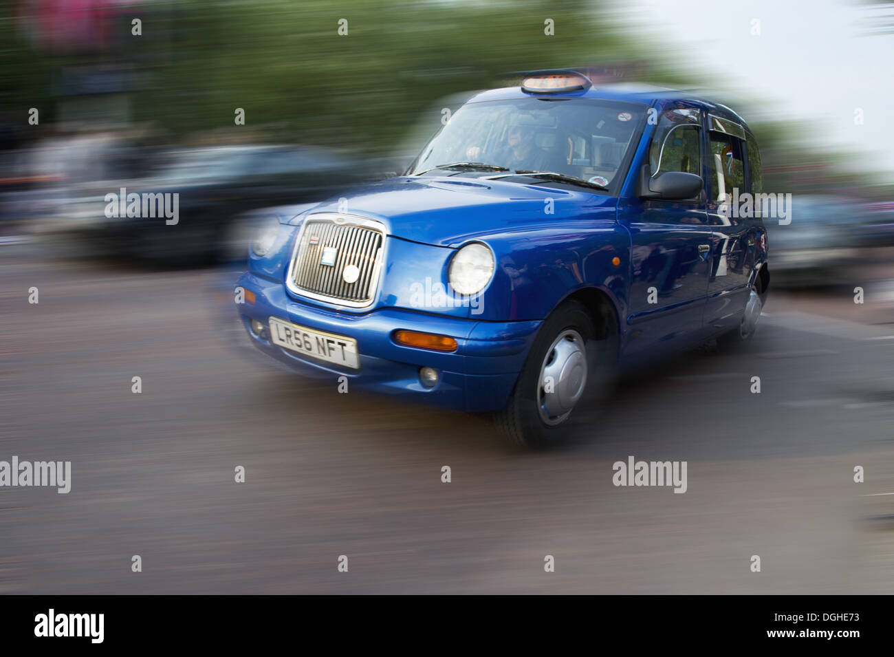 Blue taxi on city road, The Mall, City of Westminster, London, England, april - Stock Image