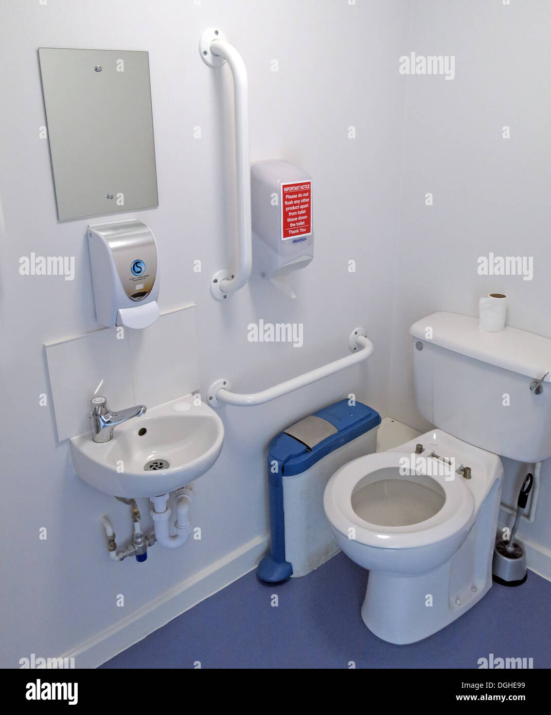 Standard disabled toilet in the UK with grab rail soap mirror wash ...