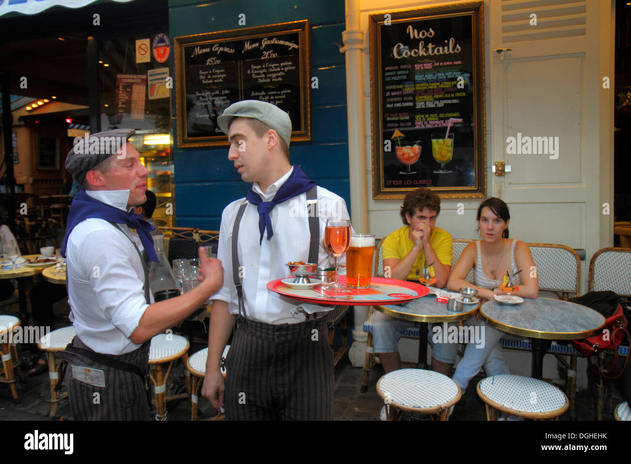 Paris France Europe French 18th arrondissement Montmatre Place du Tertre man waiter restaurant cafe uniform coworkers - Stock Image