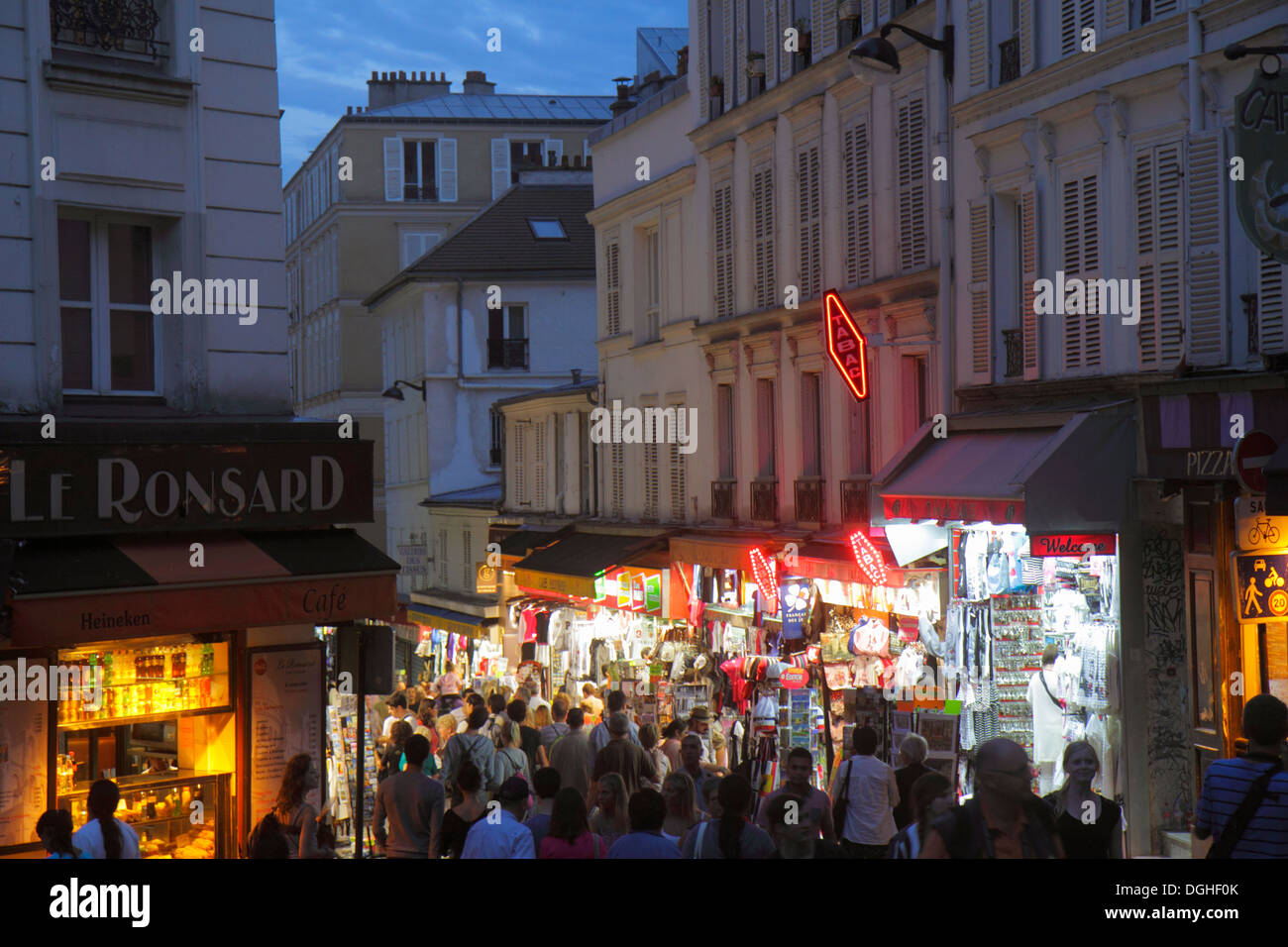 Paris France Europe French 18th arrondissement Montmatre Place Saint St. Pierre Rue de Steinkerque night nightlife shopping Haus - Stock Image