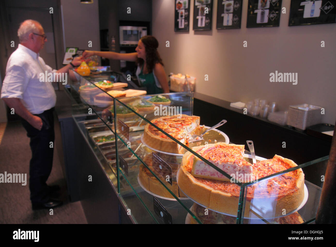 Paris France Europe French 9th arrondissement Rue Blanche quiche food display cafe brasserie restaurant customer employee man wo - Stock Image