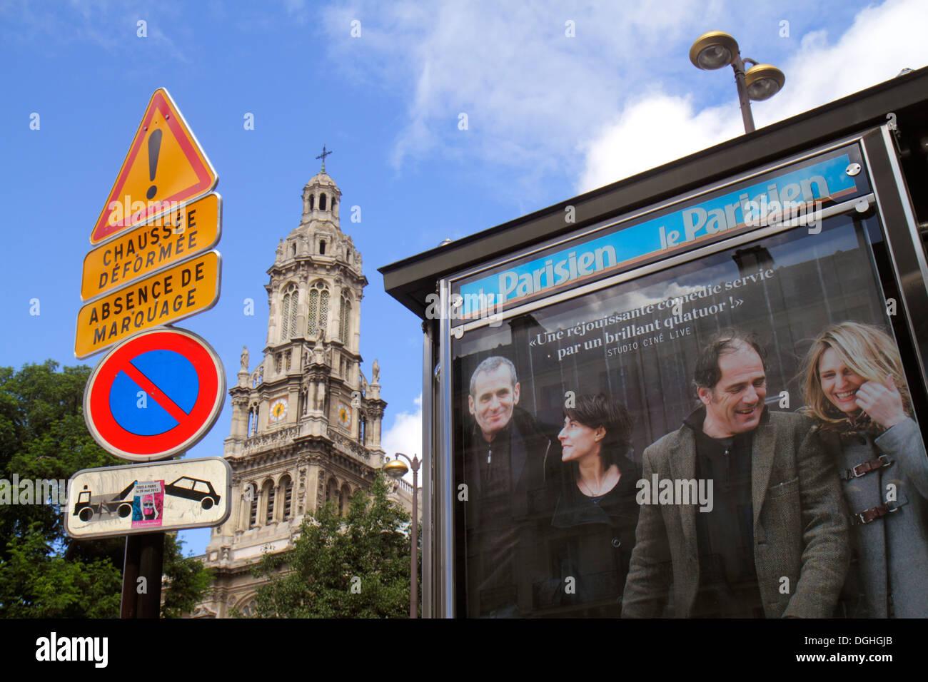Paris France Europe French 9th arrondissement Place d'Estienne d'Orves Église de la Sainte Trinité church billboard advertisemen - Stock Image