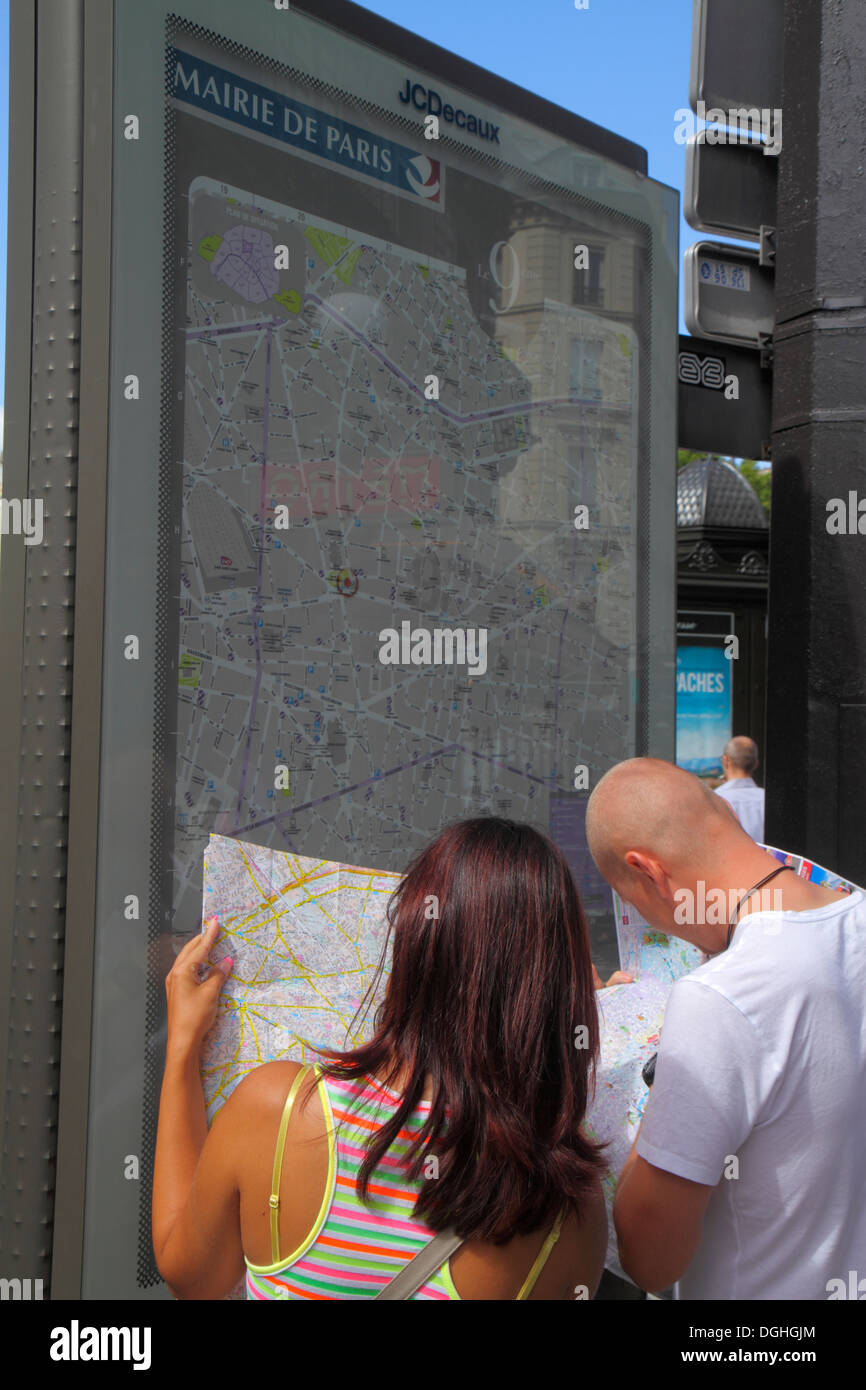 Paris France Europe French 9th arrondissement Place d'Estienne d'Orves street map man woman couple looking at - Stock Image
