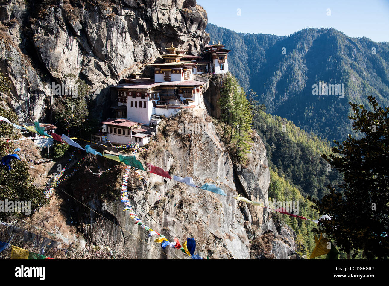 The view of Taktsang (Tigers Lair) Monastery. Perched precariously on the side of a cliff, Paro Valley Bhutan. - Stock Image