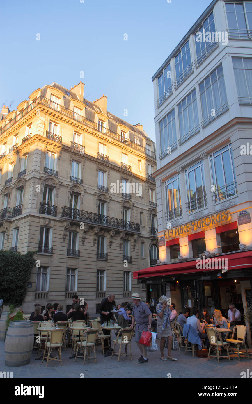 Paris France Europe French 9th arrondissement Place St. Saint Georges restaurant cafe brasserie alfresco tables chairs customers - Stock Image
