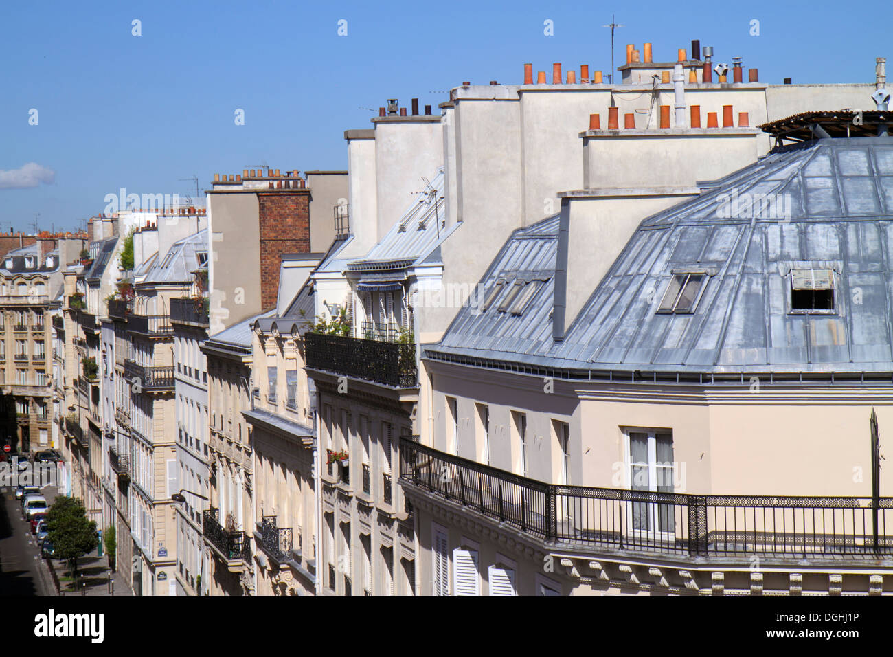 Paris France Europe French 9th arrondissement Rue la Bruyere street aerial Haussmann apartment buildings rooftops chimneys - Stock Image