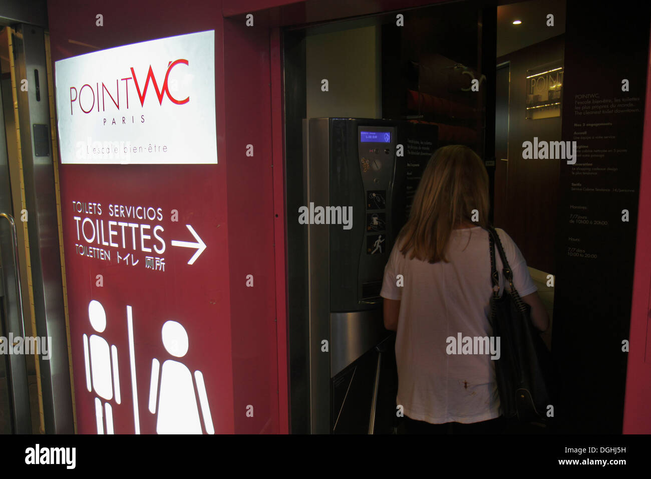 Paris France Europe French 5th arrondissement Left Bank Boulevard Saint-Germain pay toilet wc water closet woman entering - Stock Image