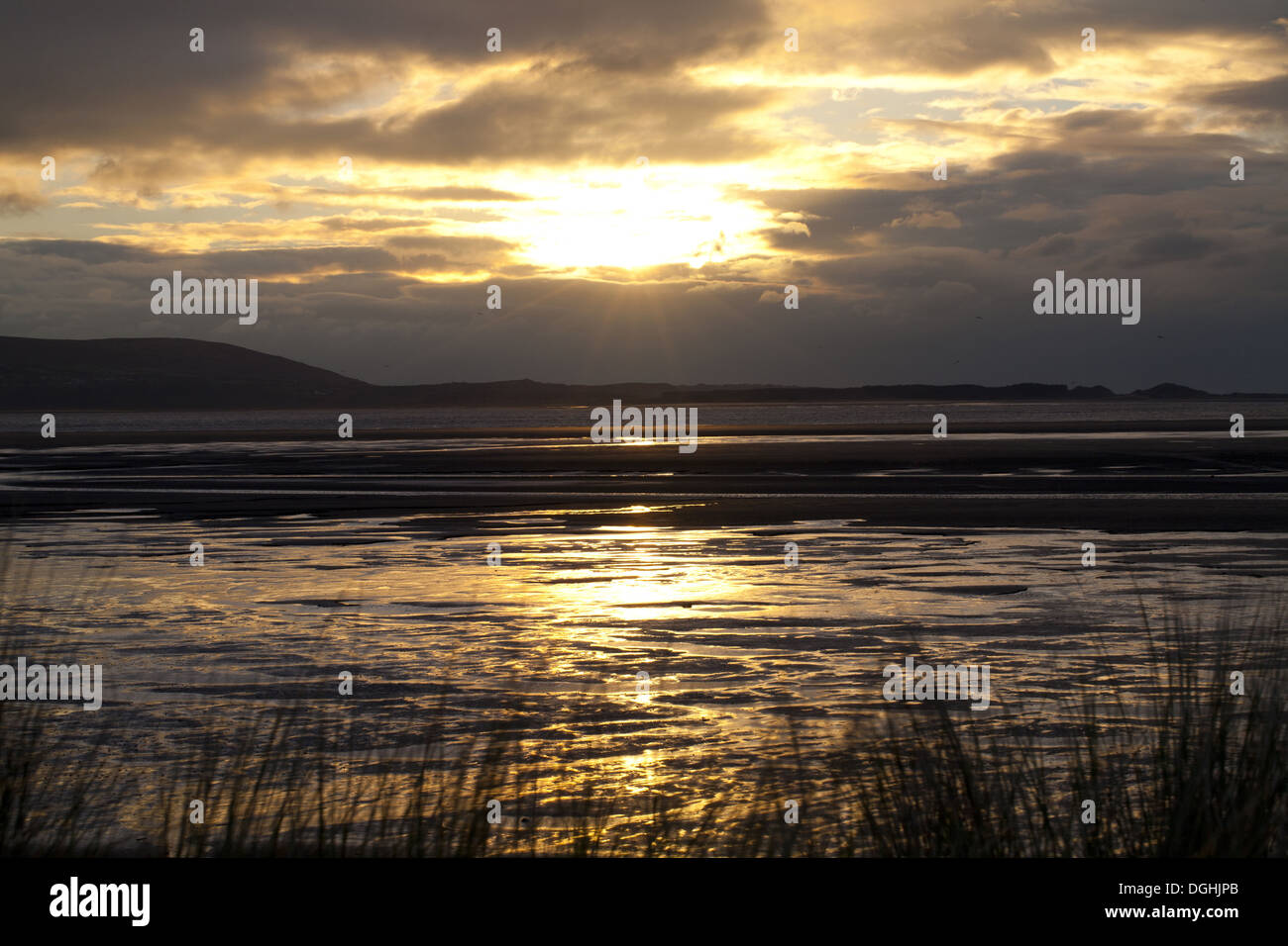 View across estuary at sunset, River Loughor, from Llanelli to Gower Peninsula, Carmarthenshire, Wales, January Stock Photo