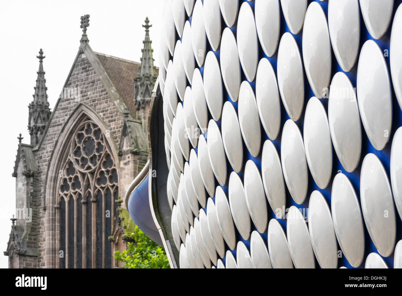 Silver disks on the Selfridges Building, St. Martins church to the rear Birmingham - Stock Image