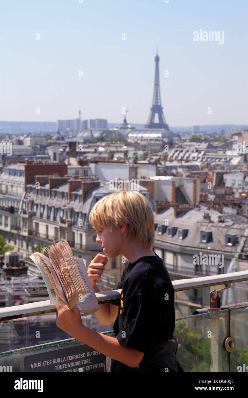 Paris France Europe French 9th arrondissement Boulevard Haussmann Au Printemps department store rooftops terrace city skyline vi - Stock Image