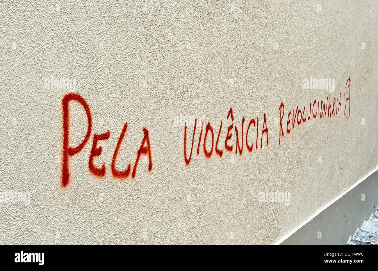 Anarchist writing 'for revolutionary violence', Alfama district, Lisbon, Portugal, Europe - Stock Image